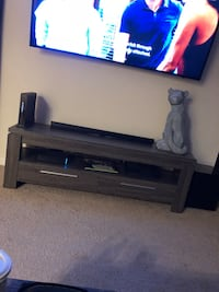 black flat screen TV with black TV stand Silver Spring, 20906