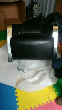 black leather padded rolling armchair Mississauga, L4Y 2C1
