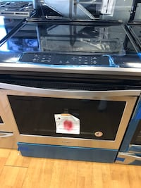 Brand New Whirlpool 4 Burner Electric Range (Scratch and Dent)
