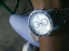 round gray chronograph watch with chain-link bracelet