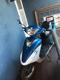 White and blue motor scooter Kelowna, V1Y 5G3