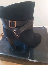 pair of black leather heeled booties Brampton, L7A 0N1