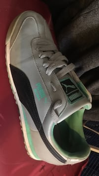 white and green puma low-top sneaker.... Lightly Worn , just need to be cleaned  Brandon, 33511