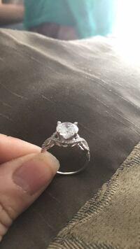 silver-colored clear gemstone solitaire ring