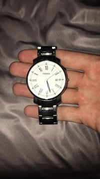 Round silver-colored analog watch with link bracelet