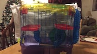 blue, yellow, and red plastic pet cage