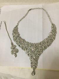 gold-colored necklace with pendant Burnaby, V5E 3G8