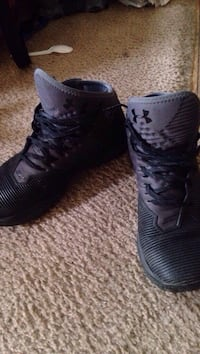 pair of black-and-gray Under Armour sneakers
