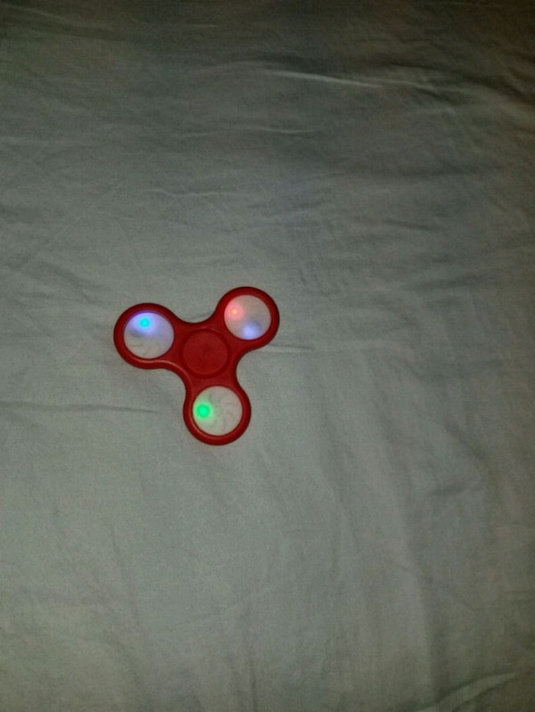 red and green fidget spinner