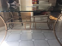 A good quality glass table and 4 chairs London, N6C