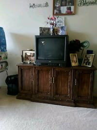 brown wooden TV hutch with flat screen television Falls Church, 22042