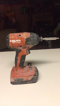 red and black Holti cordless hand drill