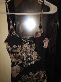 Black floral dress w/crisscross opening down the chest