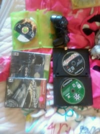 black Xbox 360 game console with game cases Salina