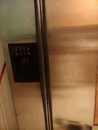 black side-by-side refrigerator with dispenser North Las Vegas, 89084