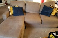 brown fabric sectional sofa with throw pillows 145 mi