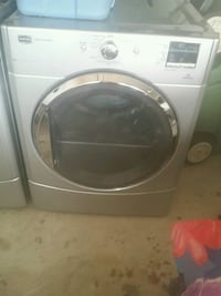 white front-load clothes washer 575 km
