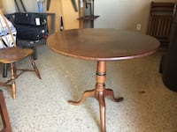 round brown wooden pedestal table 2180 mi