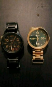 two round gold-colored chronograph watches Calgary, T1Y 4Z4