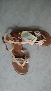 pair of Toms brown leather sandals Calgary, T3J 3R1