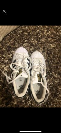Pair of white-and-black adidas sneakers Burnaby, V5J 2Z6