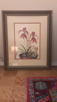 Red petaled flower painting with brown wooden frame