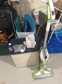 green and gray upright vacuum cleaner 533 km