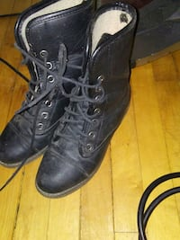 pair of black leather combat boots Calgary, T2M 1G3