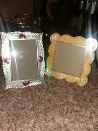 two silver and brown photo frames