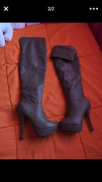 pair of blue leather knee-high boots 23 km