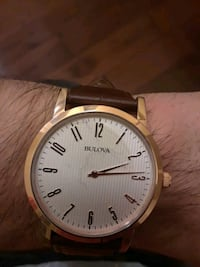round gold analog watch with brown leather strap Calgary, T3H 2E6