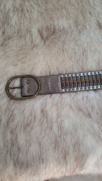 silver belt with gold buckle