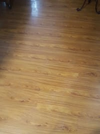 Roughly 400 foot of laminate flooring putting new