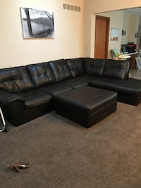 Dark Brown leather sectional sofa with ottoman