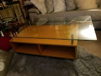 Solid wood glass coffee table with wheels from Ike Laurel, 20707