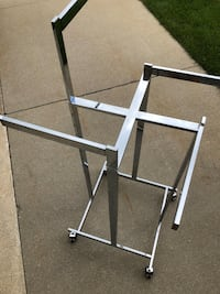 Metal 4 way cloths hanger with adjustable arms great for laundry room West Bloomfield, 48324