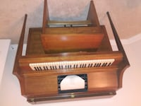brown wooden framed upright piano Cypress