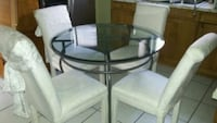 round glass top table with four chairs dining set Sarasota, 34233