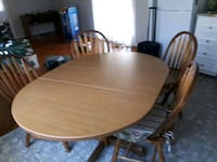 oval brown wooden dining table with four chairs Sherwood Park