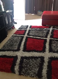 red, white, and black area rug Upper Marlboro, 20774