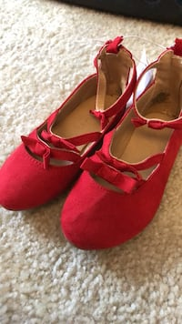 pair of red suede flats 53 km