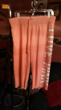 In new condition ladies pink pant size large 304 mi