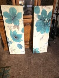 two white-and-blue flower painting wall decors