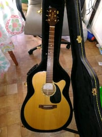 brown acoustic guitar with case Sinclairville, 14782