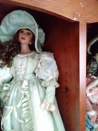 brown haired female Victorian porcelain doll Ocala, 34481