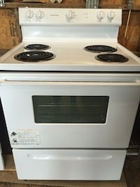 white and black Frigidaire electric coil range oven
