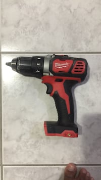 red and black Milwaukee cordless hand drill