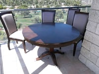 round brown wooden table with four chairs Las Vegas, 89109