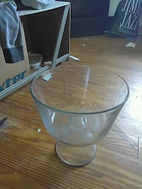 round clear glass top table with gray metal base Louisville, 40214