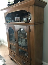 Brown wooden framed glass display cabinet Rancho Cucamonga, 91739